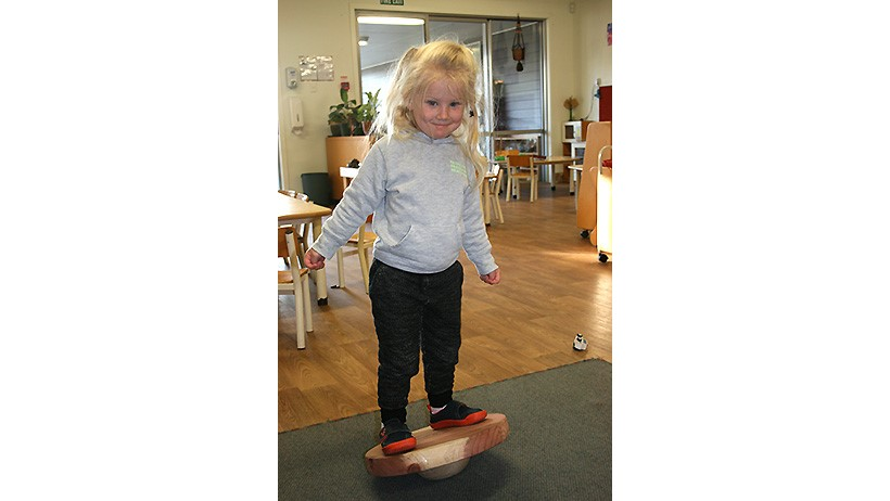 Children on wobbly board at Little Wonders Oamaru daycare